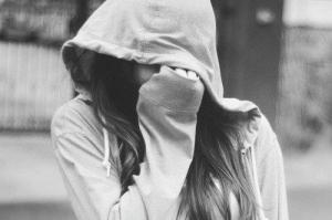 Girl hiding face B and W